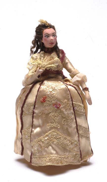"Miniature doll of Renee Asherson as 'Katharine' in ""Henry V"" made by Anne Fraser c.1940  Gift of Anne Fraser, 1996  Performing Arts Collection, Arts Centre Melbourne  As a commercial art student at the Melbourne Technical College, Anne made miniature dolls of her favourite theatrical performers. She said she would be so impressed by their performances that she ""just had to do something about it""."