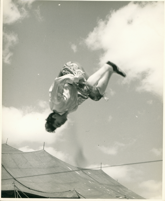 Photograph of Con Colleano performing a somersault on the tightwire