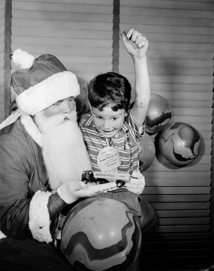 Andrew Lahey was one happy little boy at the Shell Club Christmas Party at Luna Park on the 17th December 1960. LH 3247 Laurie Richards Collection. Performing Arts Collection, Arts Centre Melbourne